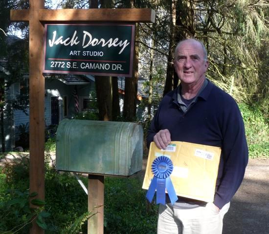 Jack Dorsey holding prize ribbon